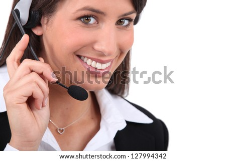 Smiling woman with headset - stock photo