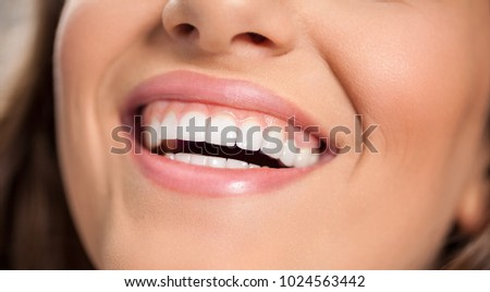 Smiling woman with healthy white teeth. Teeth care.