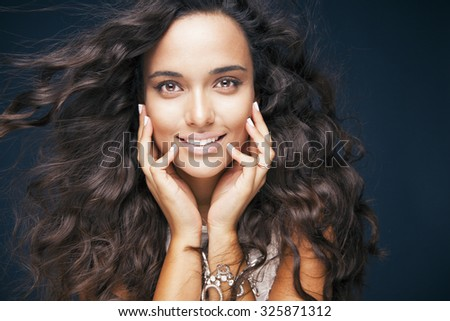 Smiling woman with long shine windy hair and bright makeup . Long healthy hair and cosmetics concept. Studio shot, Copy space for your text, Horizontal - stock photo
