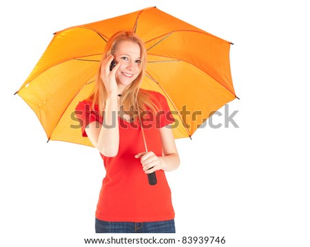 smiling woman with orange umbrella peaks by a mobile phone