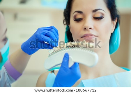 smiling woman with palette for tooth color