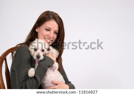 Smiling woman with pet poodle