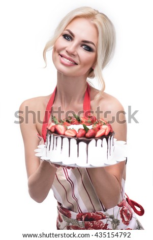 smiling woman with strawberry decoration from delicious cream tart cake which she is holding in her hand, studio, white background, isolated - stock photo