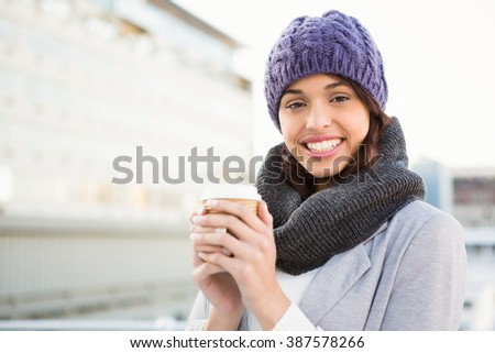 Smiling woman with take-away coffee outdoor