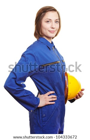 Smiling woman worker in blue overall and helmet - stock photo