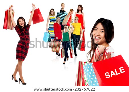 Smiling women with colorful shopping bags - stock photo