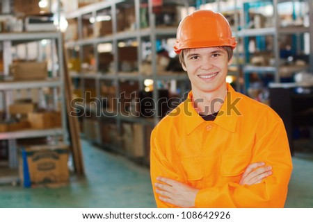 Smiling worker at a warehouse - stock photo