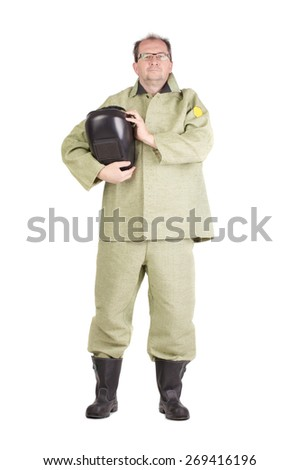 Smiling worker holding welder mask. Isolated on a white background. - stock photo