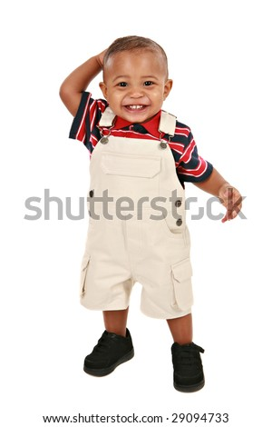 Smiling 1-year old baby boy standing facing camera on isolated background - stock photo