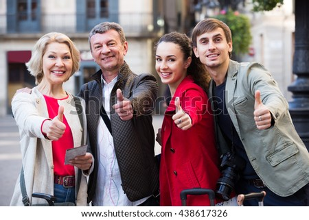 Smiling young and mature couple outside in sunny day - stock photo