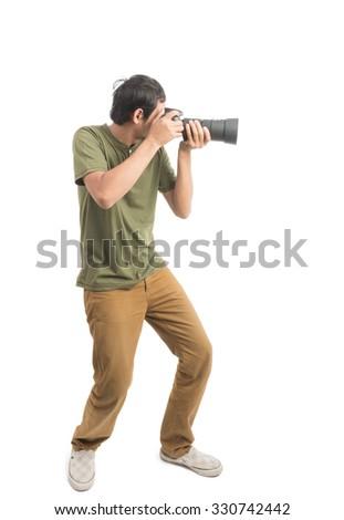 Smiling Young Asian photographer holding camera isolated on white background - stock photo