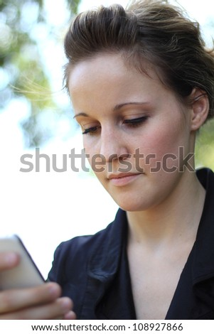 Smiling Young Attractive Businesswoman On the Phone - stock photo