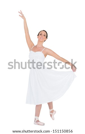 Smiling young ballet dancer posing on white background with her leg back - stock photo