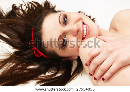 smiling young beautiful woman lying on floor