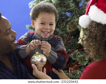 Smiling Young Boy with Christmas Ornament - stock photo