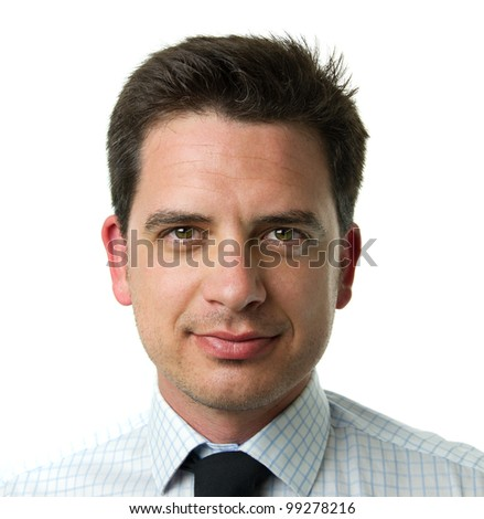 Smiling young business man. Close up portrait over monochrome white background - stock photo