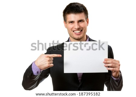 Smiling young business man,showing a white card.
