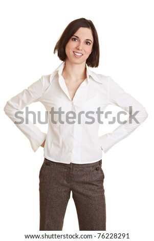 Smiling young business woman with her arms akimbo - stock photo