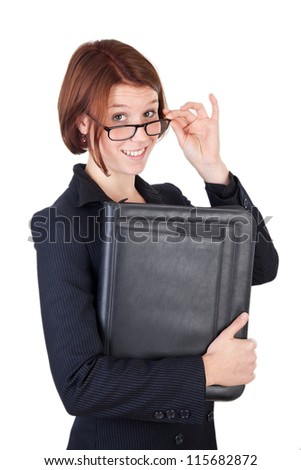 Smiling young business woman with leather map - stock photo