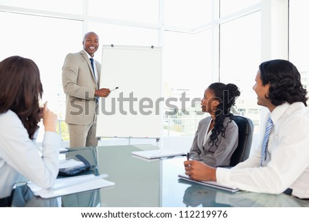 Smiling young businessman giving a presentation
