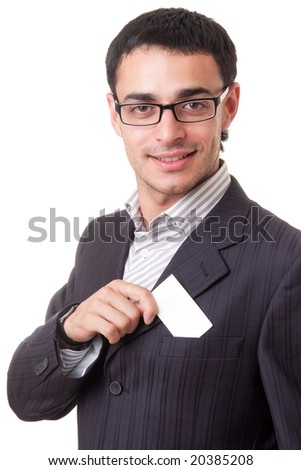 smiling young businessman holding a blank business card, isolated on white background