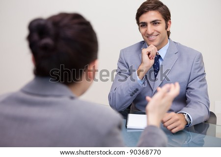 Smiling young businessman in a negotiation