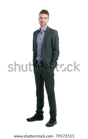 Smiling young businessman standing relaxed with hands in pockets isolated on white background - stock photo