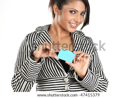 Smiling Young businesswoman holding blue credit card - stock photo