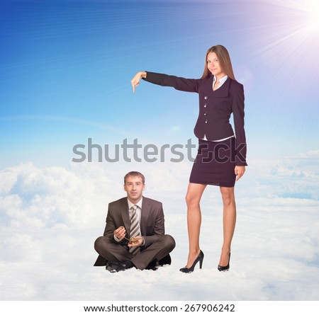 Smiling Young Businesswoman Pointing to Businessman, Sitting on the Clouds While Looking at the Camera, on a Sunny Background - stock photo