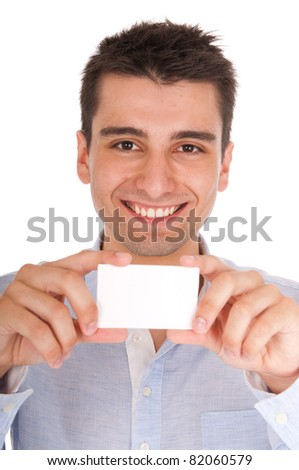 smiling young casual man holding blank white card (isolated on white background)