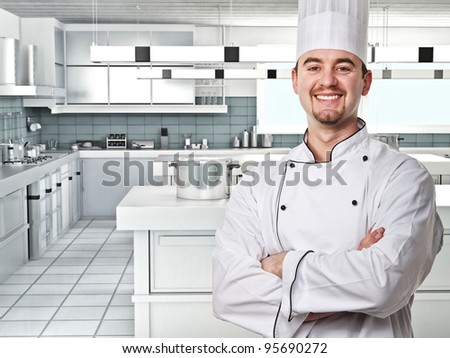 smiling young chef in modern kitchen - stock photo