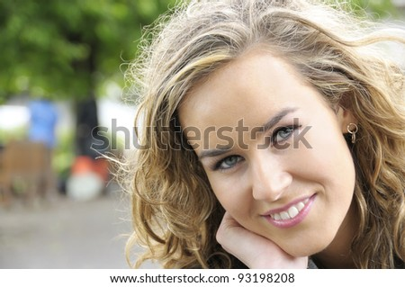 Smiling young college student on campus, short depth of field. - stock photo