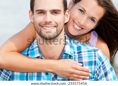 Smiling young couple. - stock photo