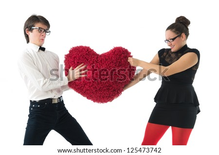 smiling young couple holds a large hairy red heart