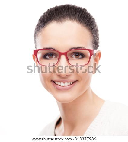 Smiling young fashion model posing on white background wearing red stylish glasses - stock photo