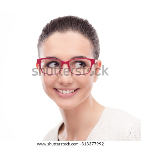 Smiling young fashion model posing on white background wearing red stylish glasses