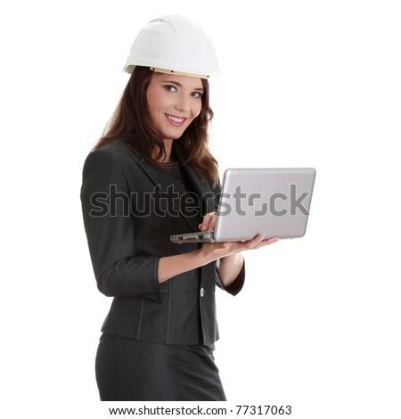 Smiling young female architect holding small laptop, isolated on white background - stock photo