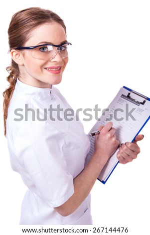 Smiling young female doctor holding paperclip isolated on white background.