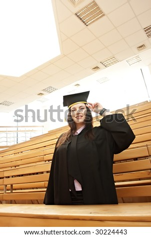 Smiling young female graduate