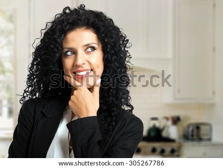 Smiling young female manager having an idea - stock photo