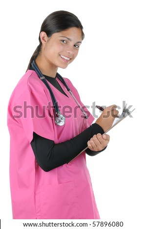 Smiling young female medical professional in scrubs writing in patients chart. Vertical format isolated on white - stock photo