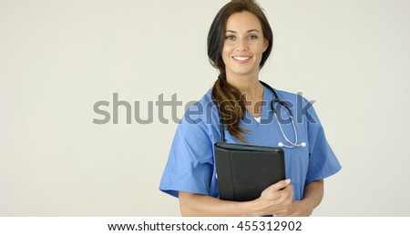 Smiling young female physician smiles at camera - stock photo