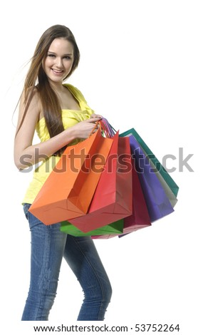 smiling young female posing with shopping bags isolated on white - stock photo