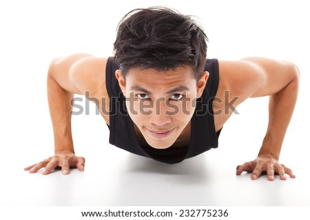 smiling young fitness man exercising push up - stock photo
