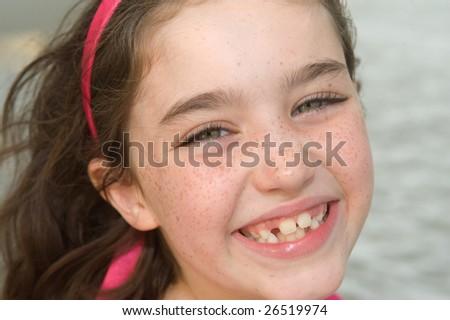 Smiling Young Girl at the Beach