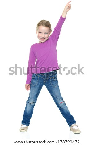 Smiling young girl in front of white background - stock photo