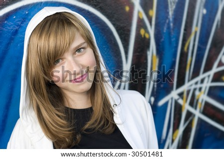 Smiling young girl on graffiti background