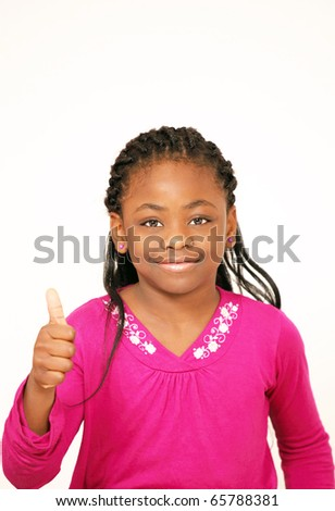 Smiling young girl thumbs up sign - stock photo