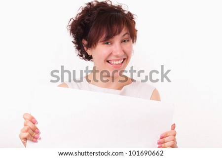 Smiling young girl with a big piece of white paper - stock photo