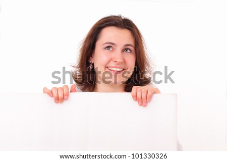Smiling young girl with a sheet of paper - stock photo